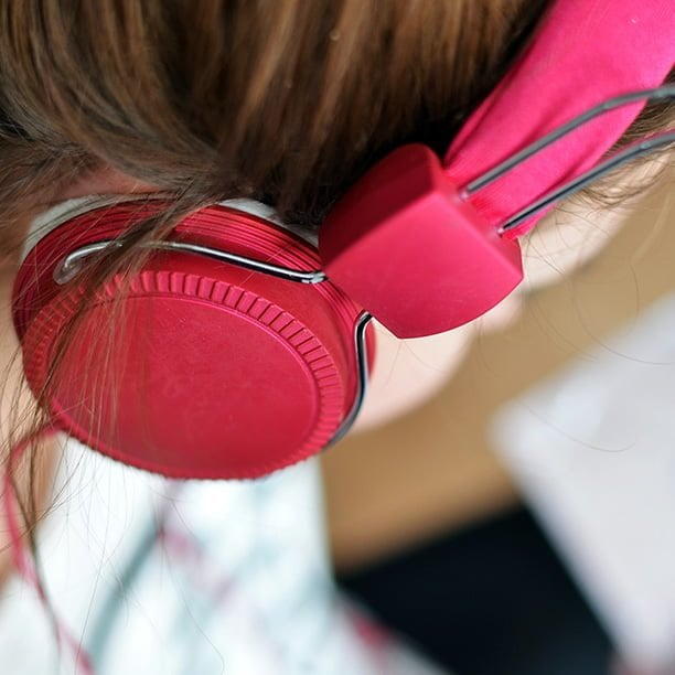 female wearing red headphones